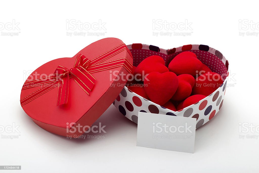Gift box and hearts with a empty card royalty-free stock photo