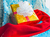 Gift box and red knit scarf, Christmas