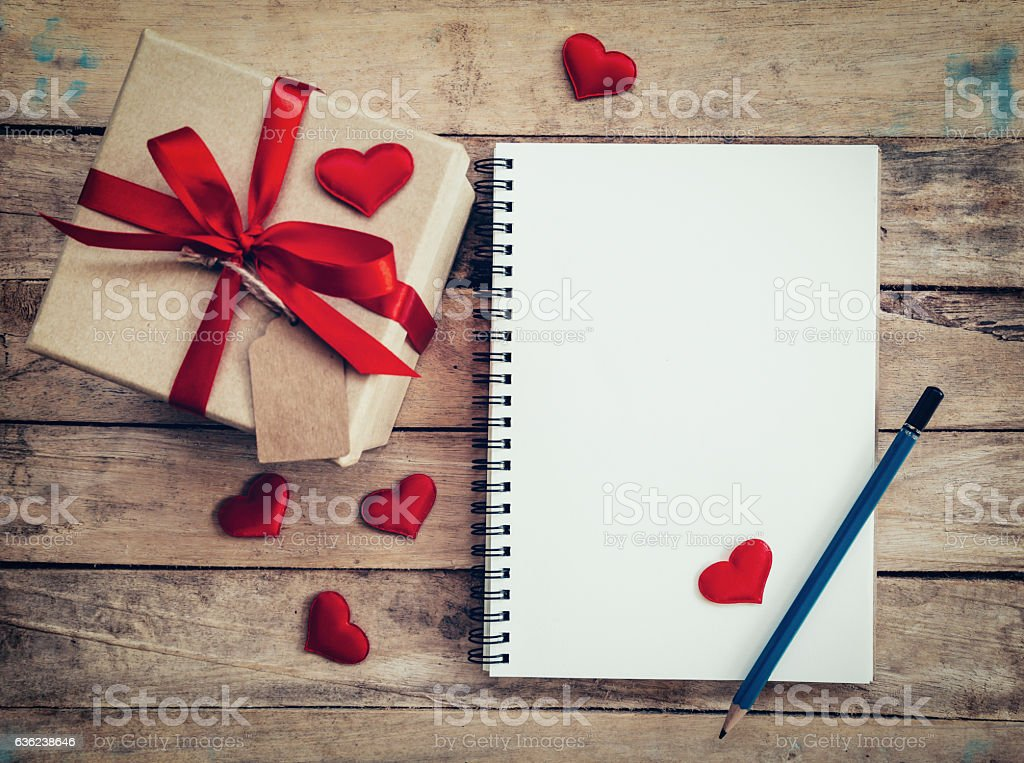 gift box and red ribbon and red heart with notebook stock photo