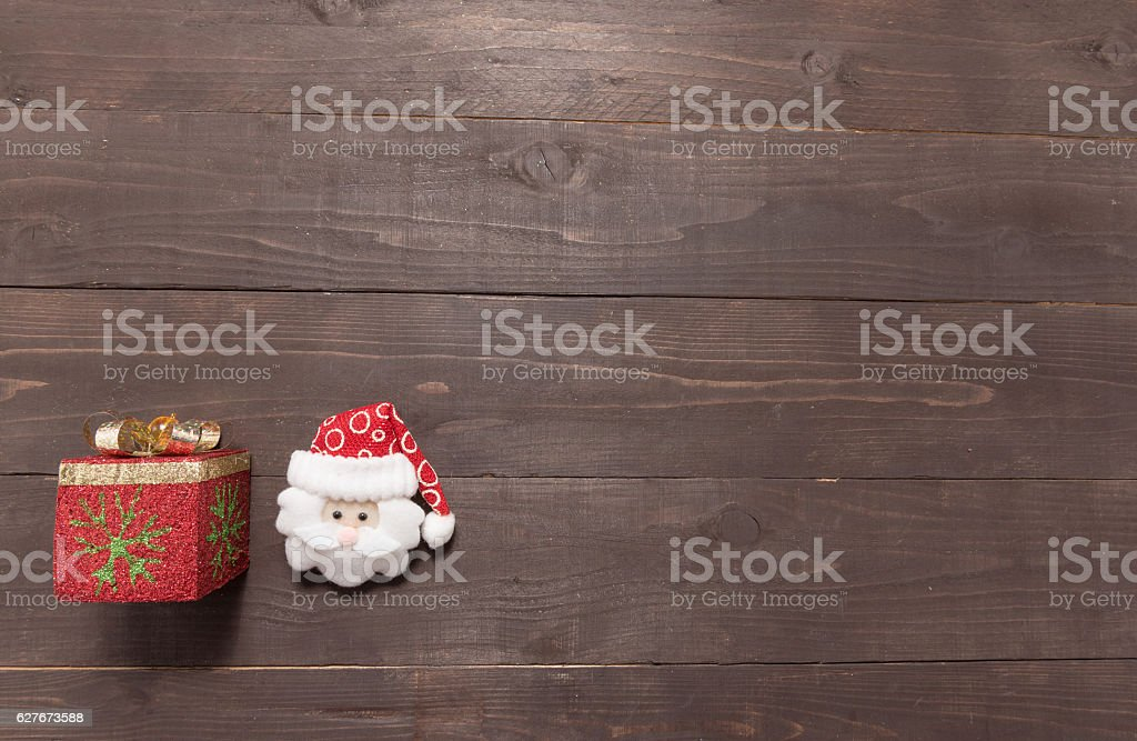 Gift box and santa on the wooden background stock photo