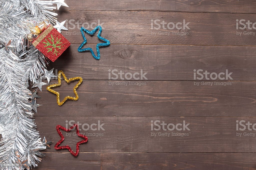 Gift box and stars are on the wooden background stock photo