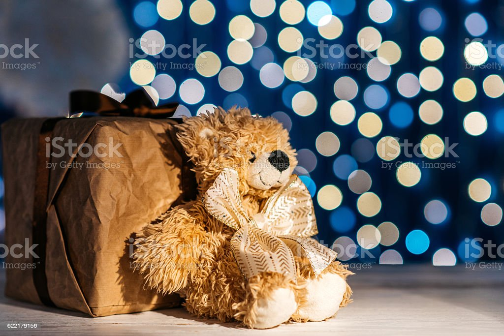Gift box and teddy bear stock photo