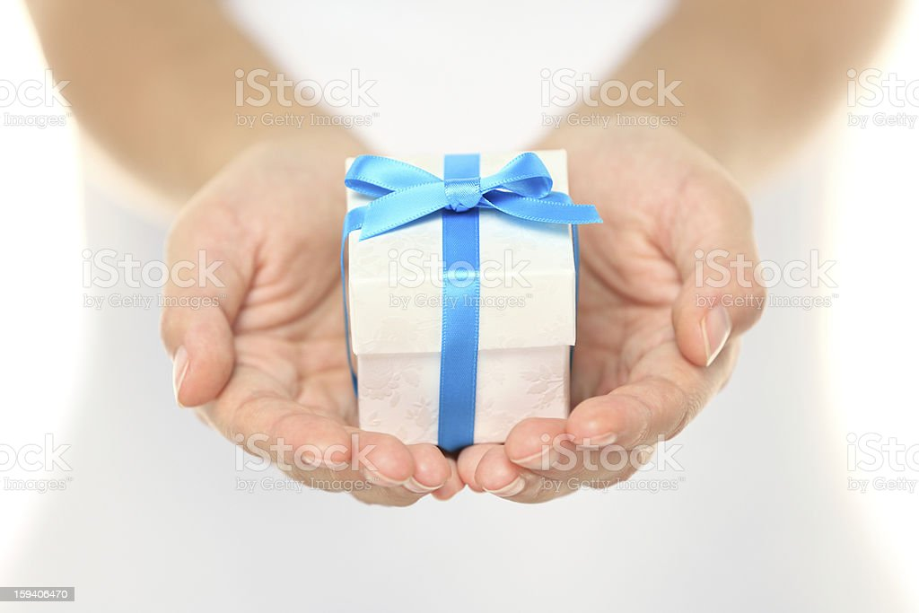 Gift box in female hands stock photo