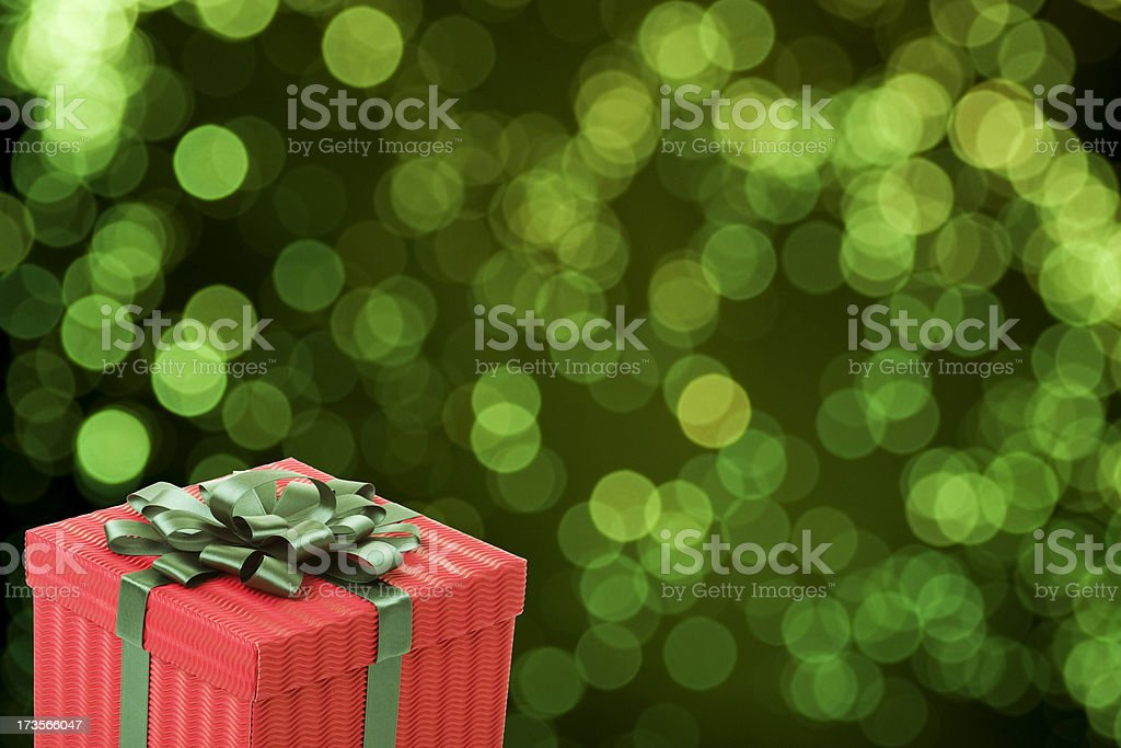 Gift Box in Green Lights Background royalty-free stock photo
