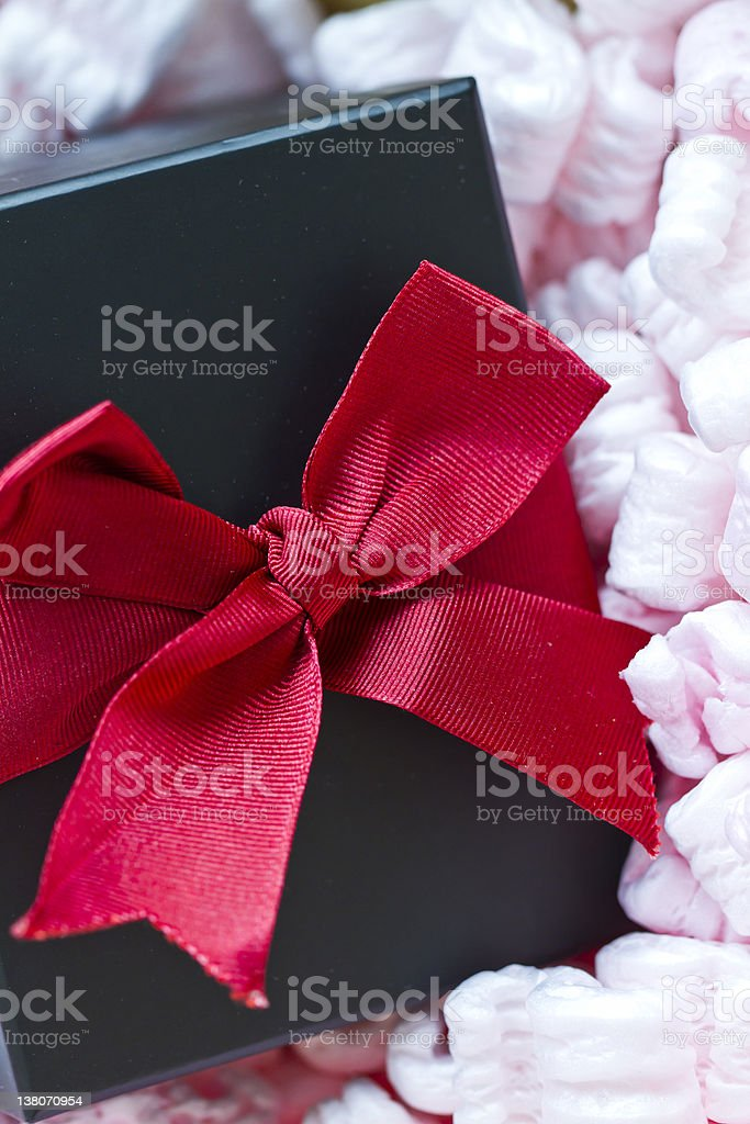gift box in packaging peanuts royalty-free stock photo