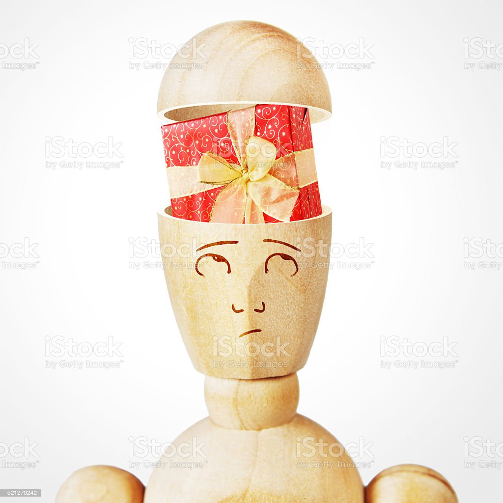 Gift box into the human head stock photo