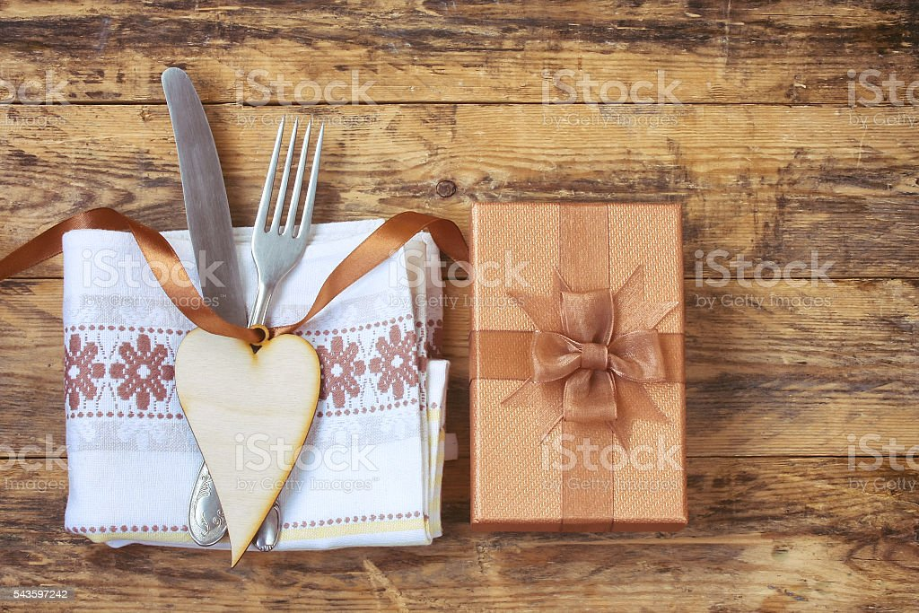 gift box, knife, fork, heart on silk ribbon stock photo