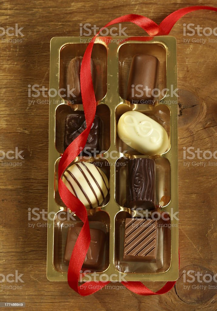 gift box of chocolate candies on a wooden background royalty-free stock photo