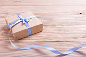 Gift box of kraft paper with ribbon
