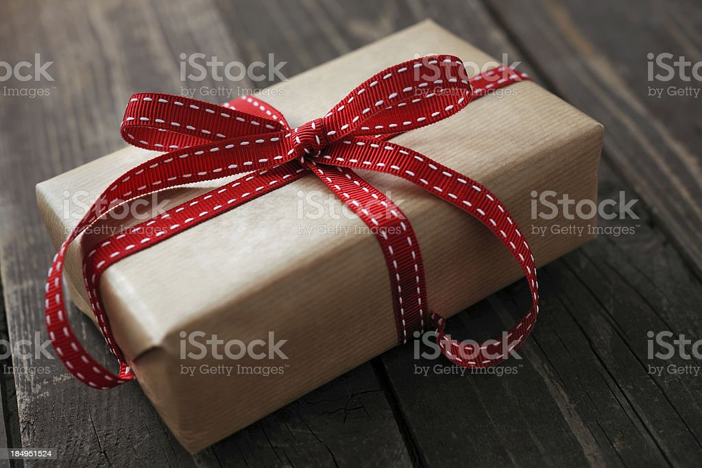 Gift box on an old wooden background royalty-free stock photo