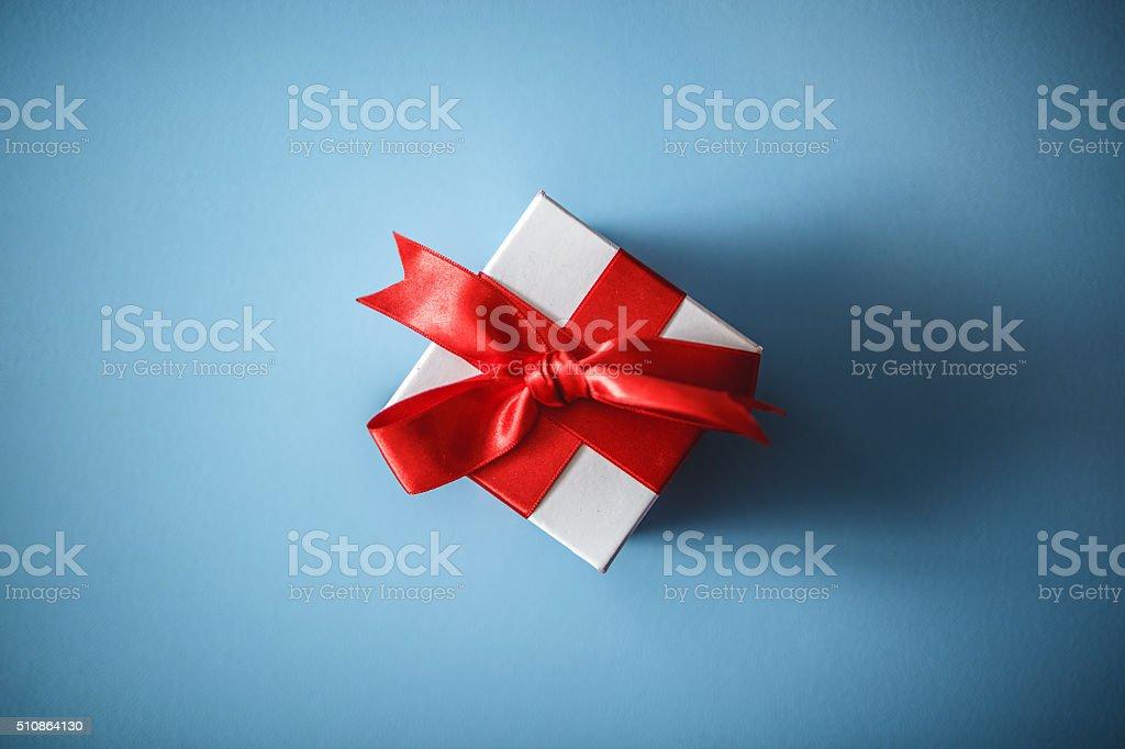 Gift box on blue background stock photo