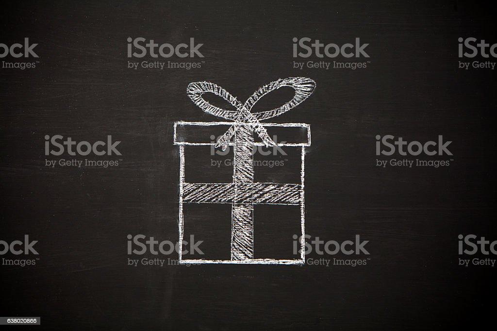Gift box on chalkboard background stock photo