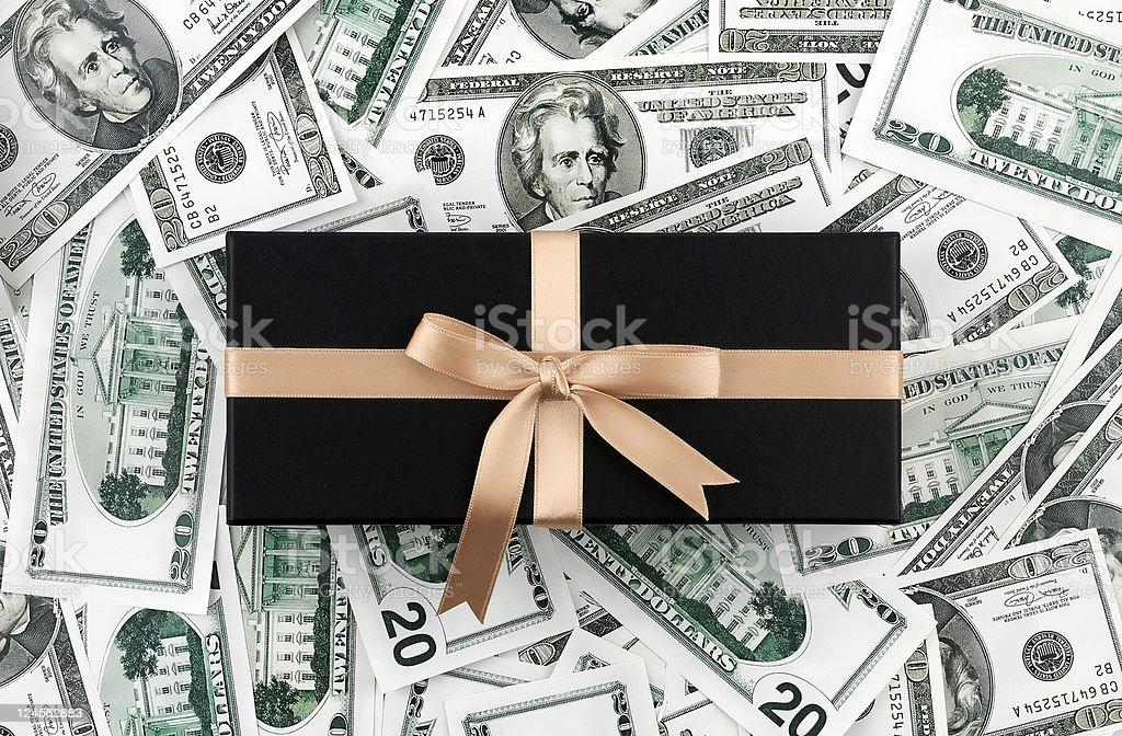 Gift Box on dollars royalty-free stock photo