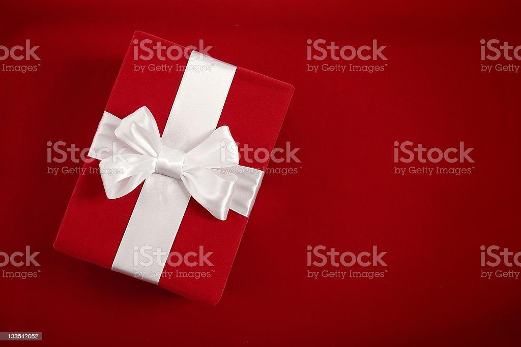 Gift box on red velvet background royalty-free stock photo