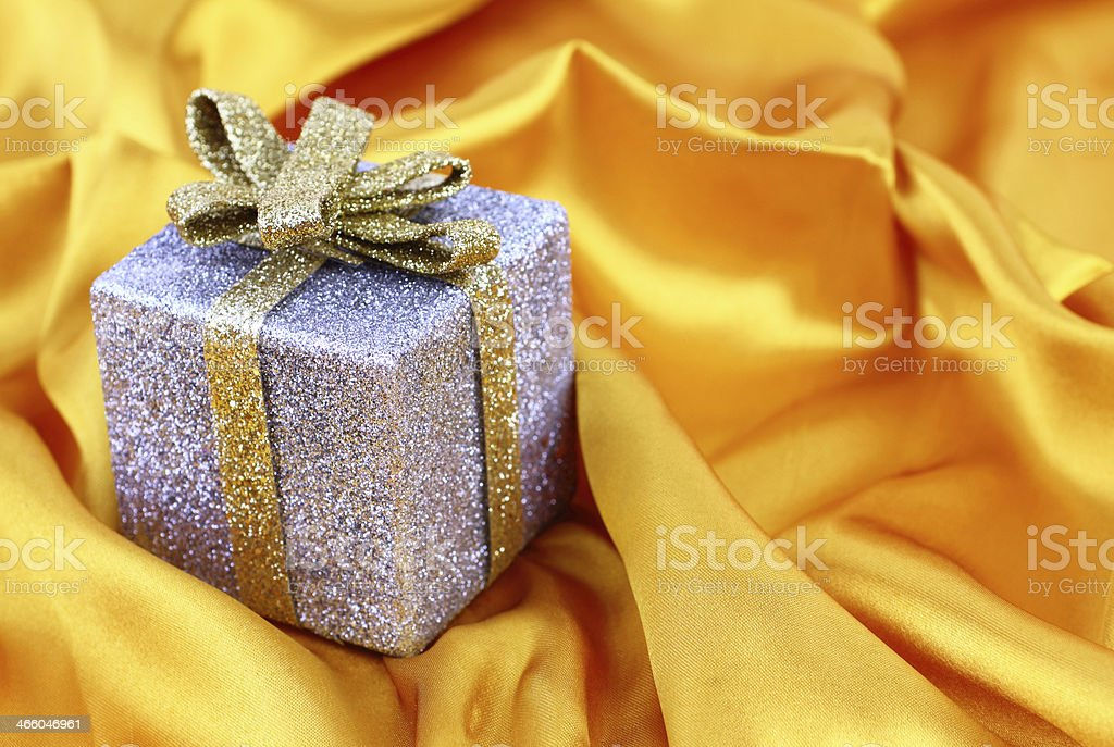 Gift box on satin royalty-free stock photo