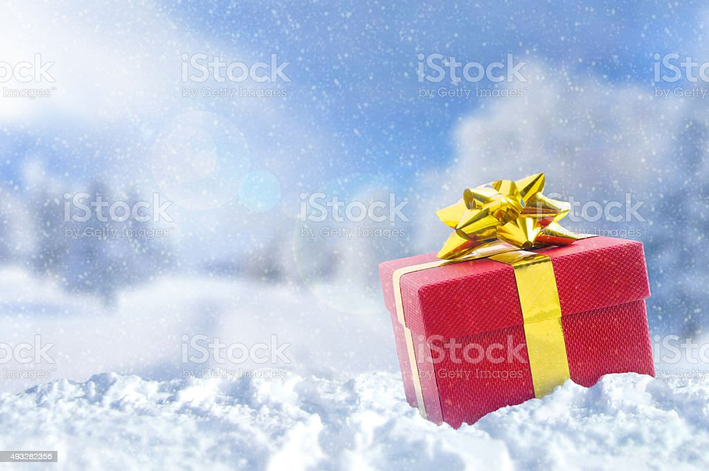 Gift box on snow at Christmas outside stock photo
