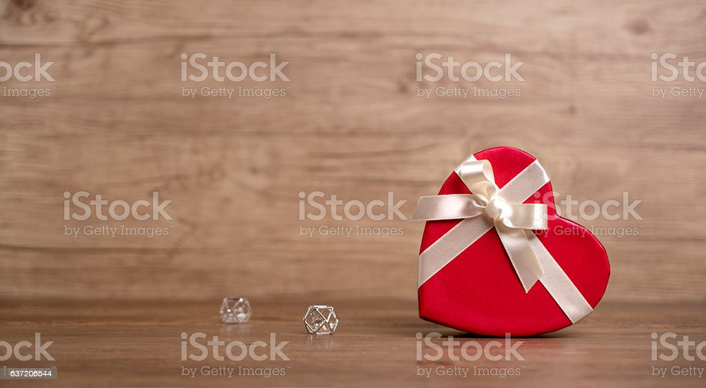 Gift box on the wooden background. Valentine's Day gift. Red box. stock photo