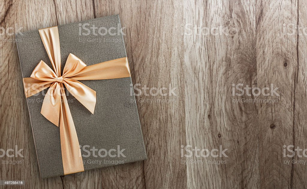 Gift box on wood, top view stock photo