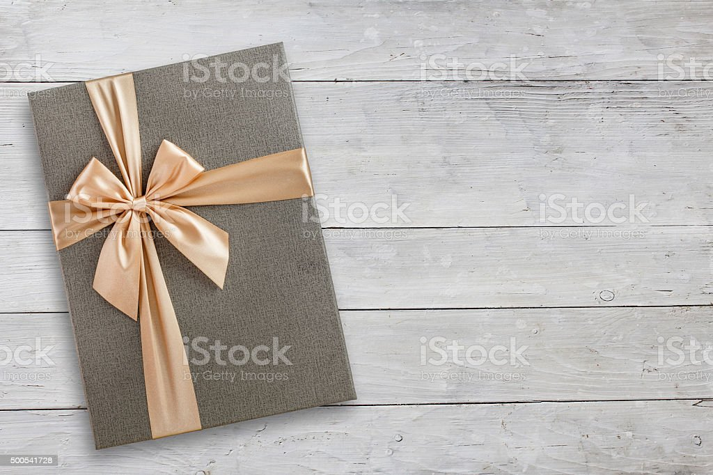 Gift box over white wood stock photo