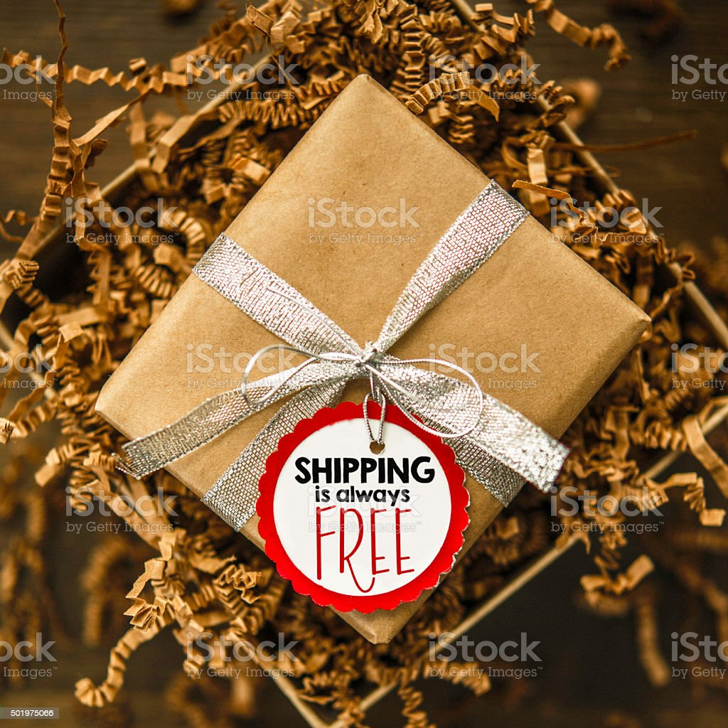 Gift box ready to be shipped with Free Shipping tag stock photo