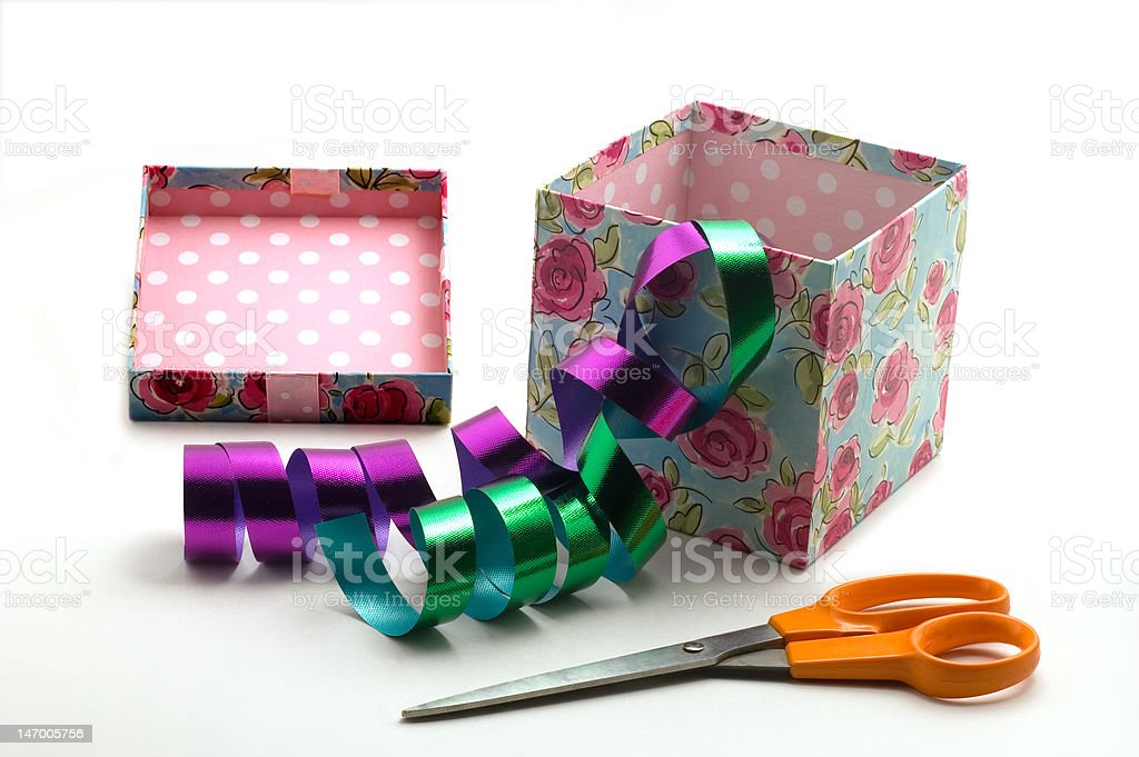 Gift box, ribbons and scissors royalty-free stock photo