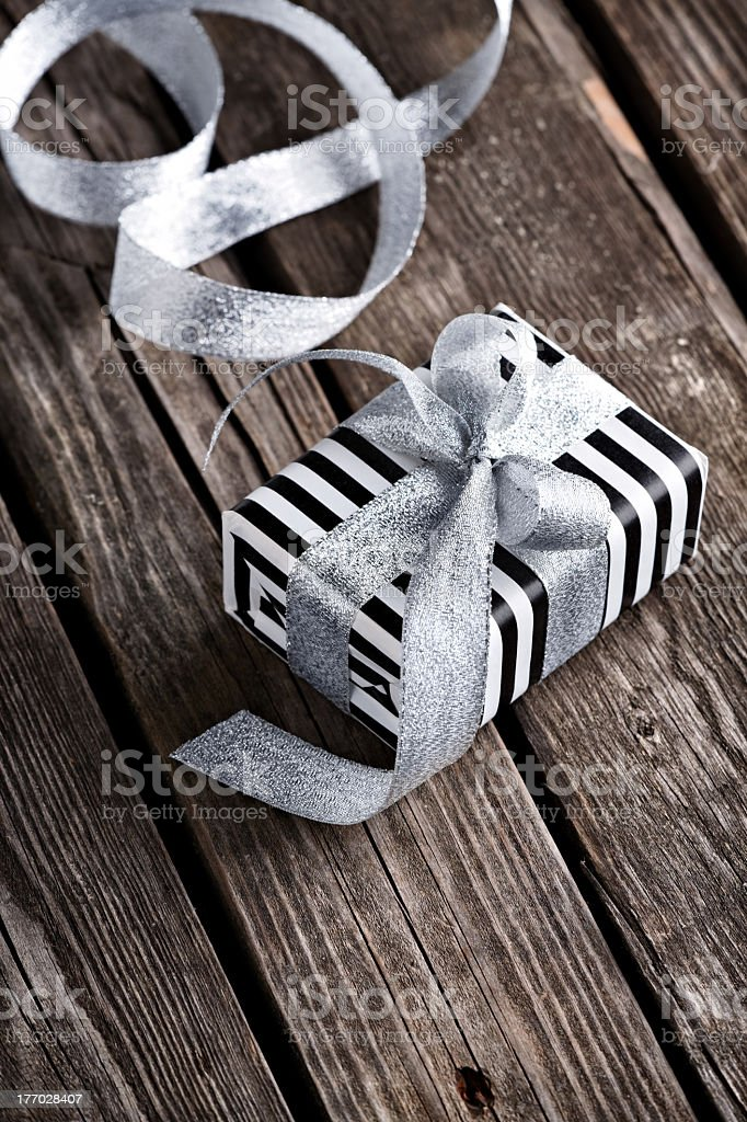 Gift box tied silver bow royalty-free stock photo