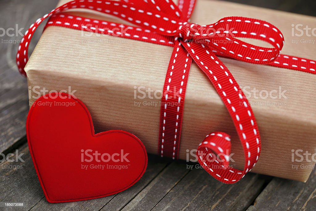 Gift box with a red heart stock photo