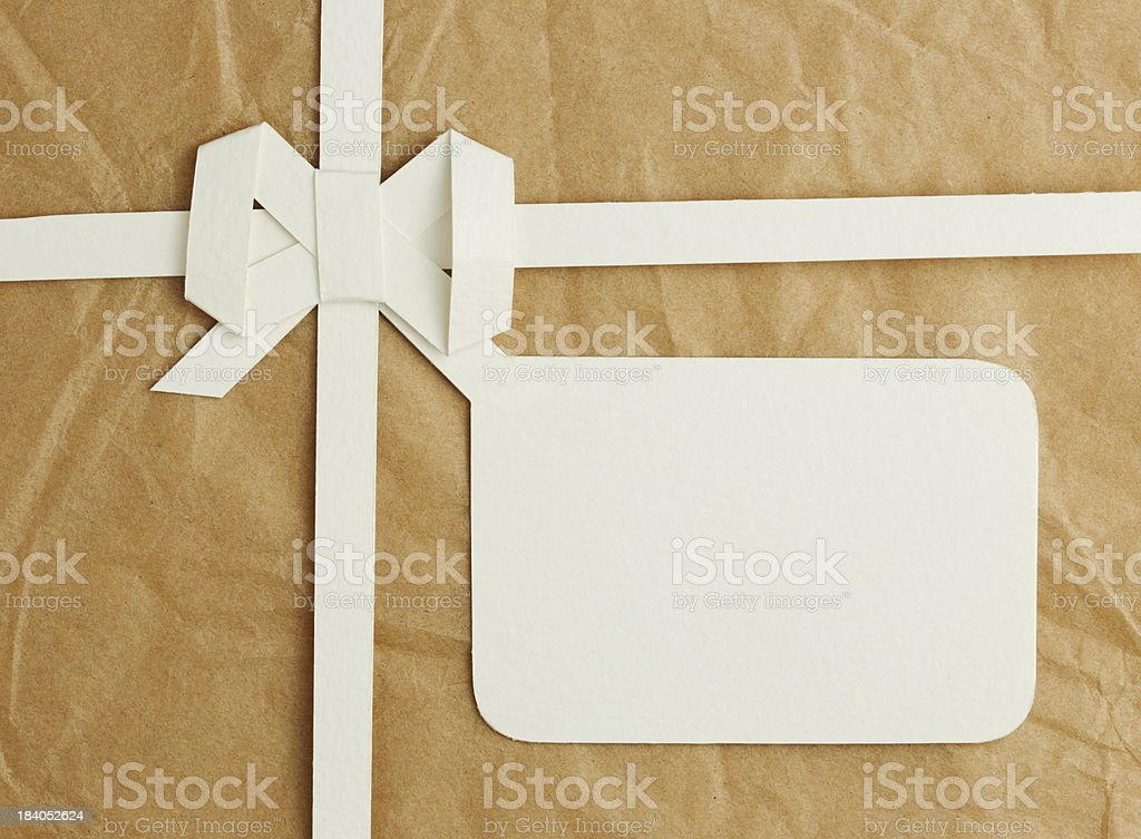 Gift box with blank  tag royalty-free stock photo