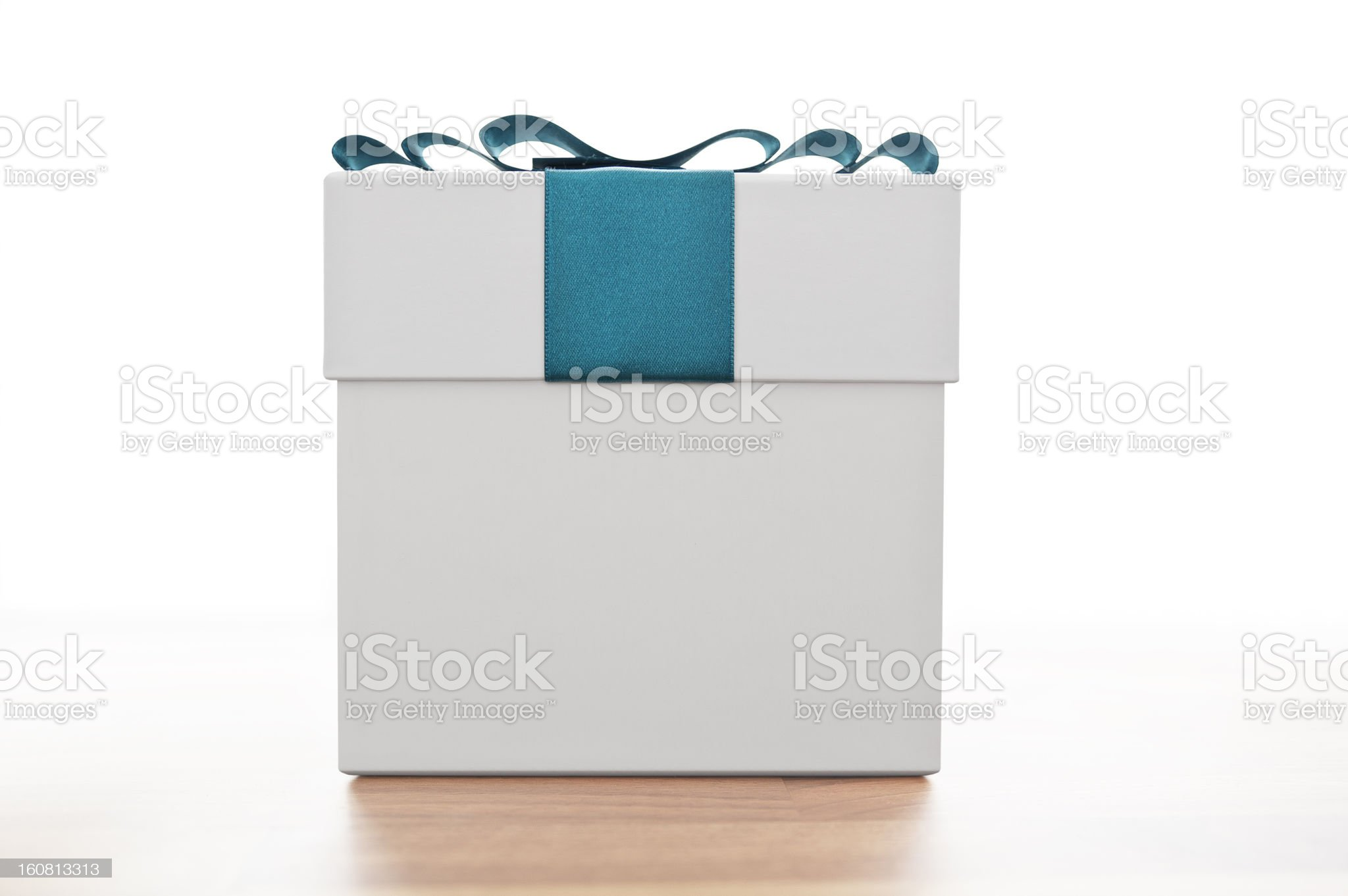Gift box with blue ribbon royalty-free stock photo