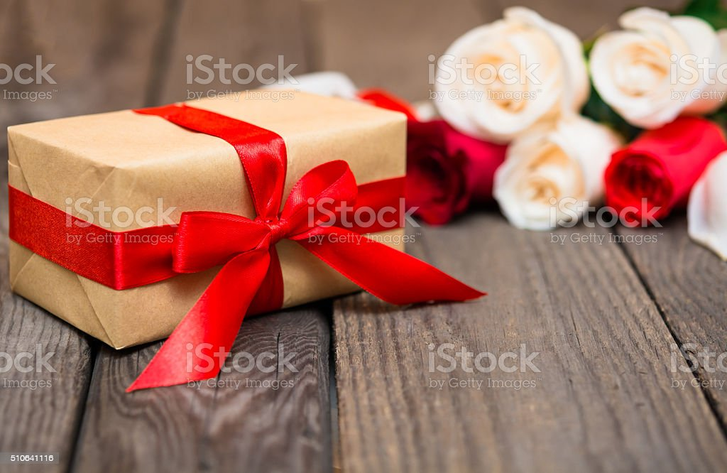 Gift box with blured red and white roses stock photo