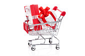Gift box with bow in shopping cart