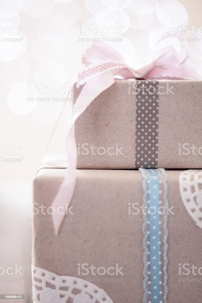 Gift box with brown paper and bows with Christmas lights stock photo