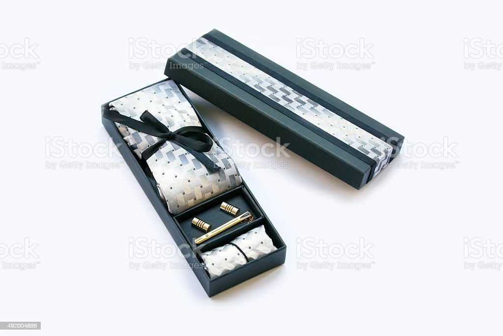 Gift box with cufflinks, tie and tie clip, handkerchief. stock photo