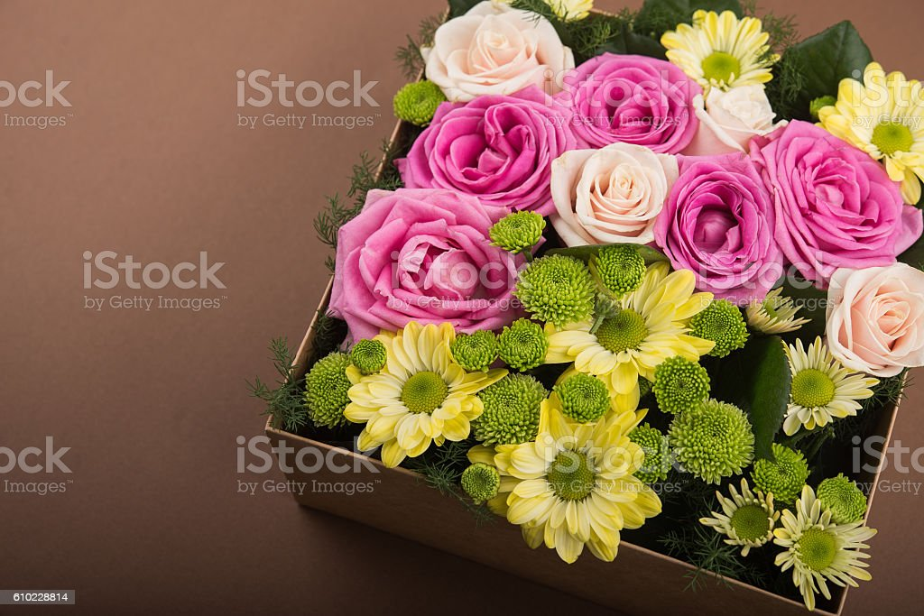 Gift box with flowers on vintage brown background
