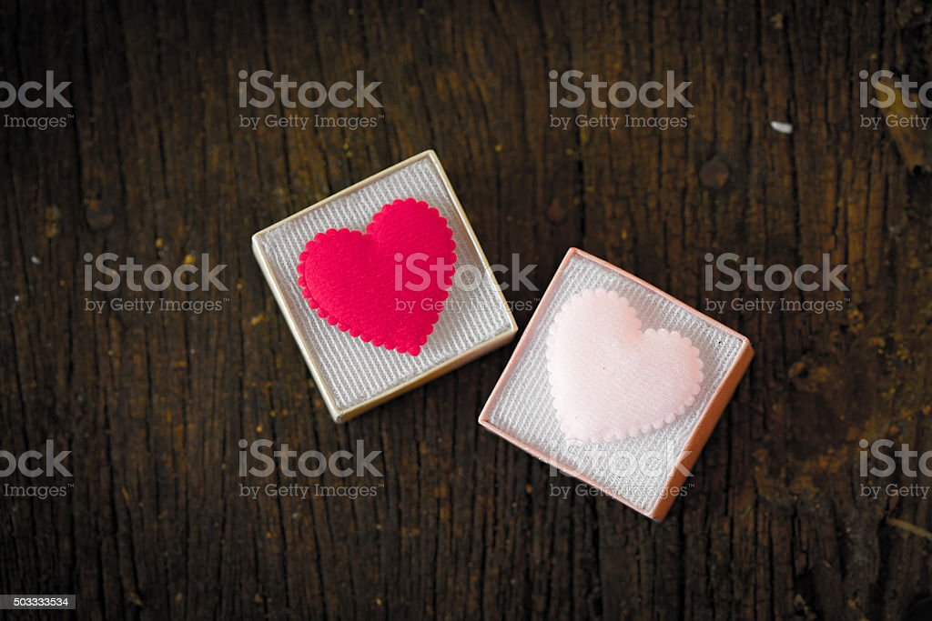 Gift box with heart on wooden table, Valentine day stock photo