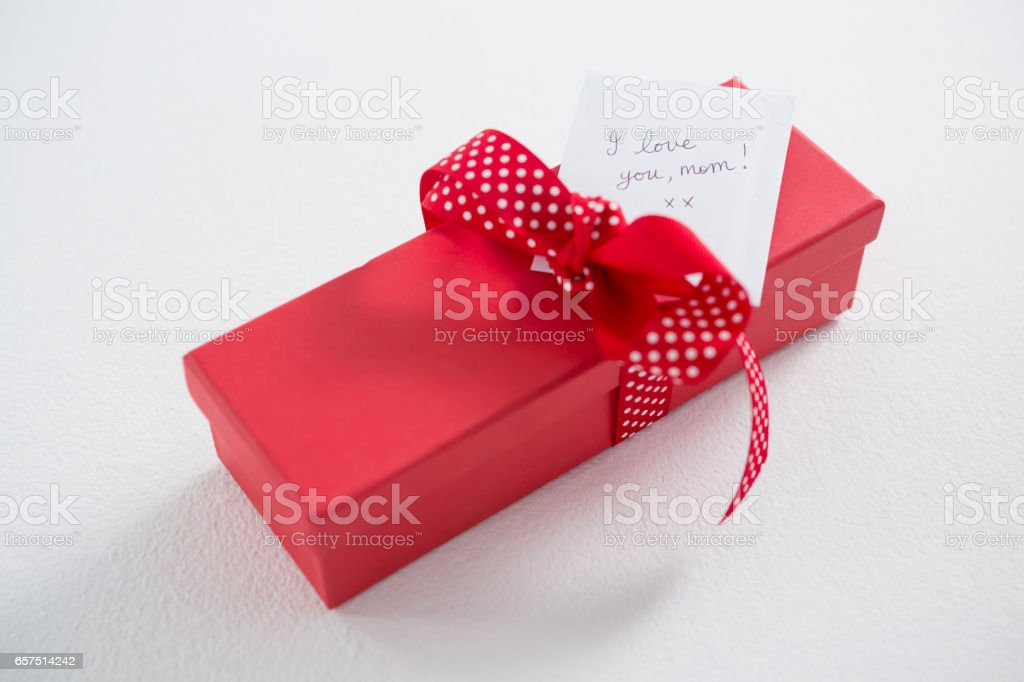 Gift box with I love u mom text on white background stock photo