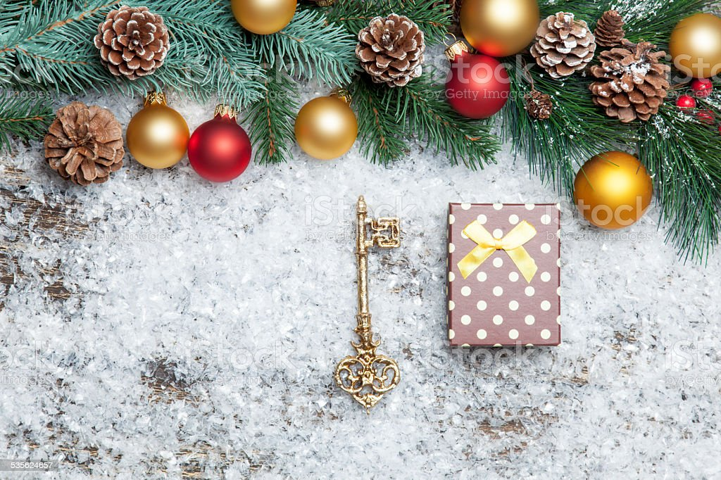 gift box with key and branch with toys.
