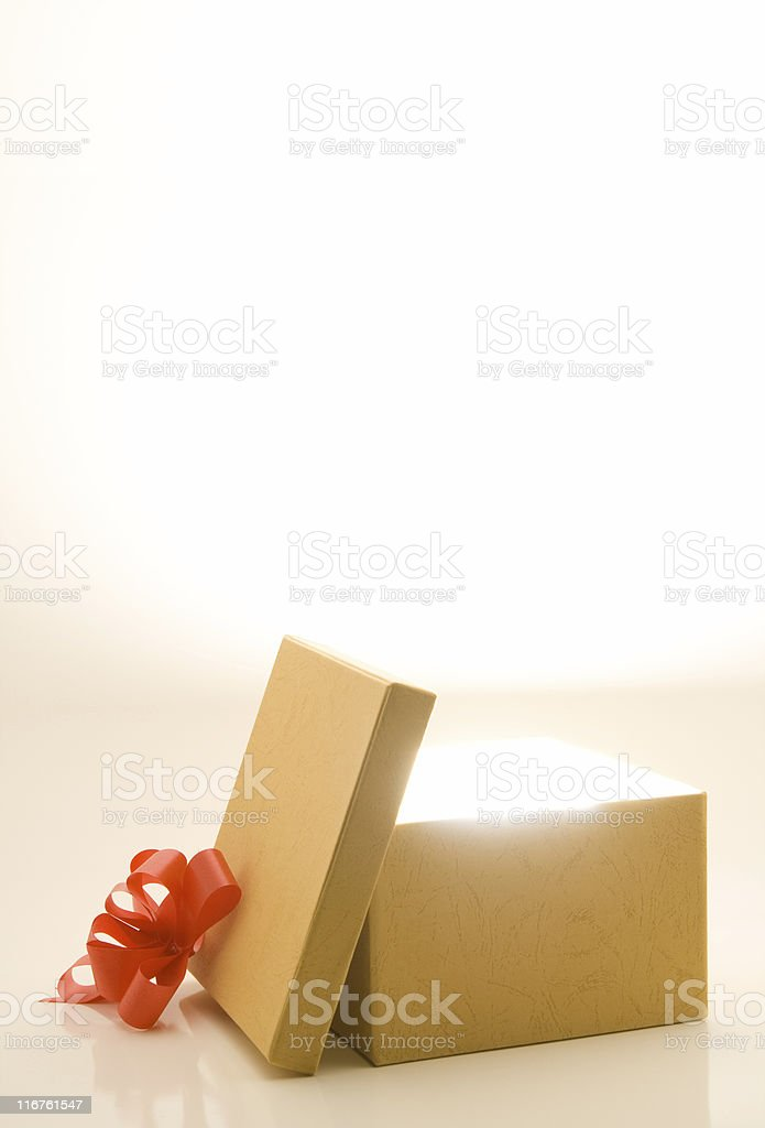 Gift box with light and room for text stock photo
