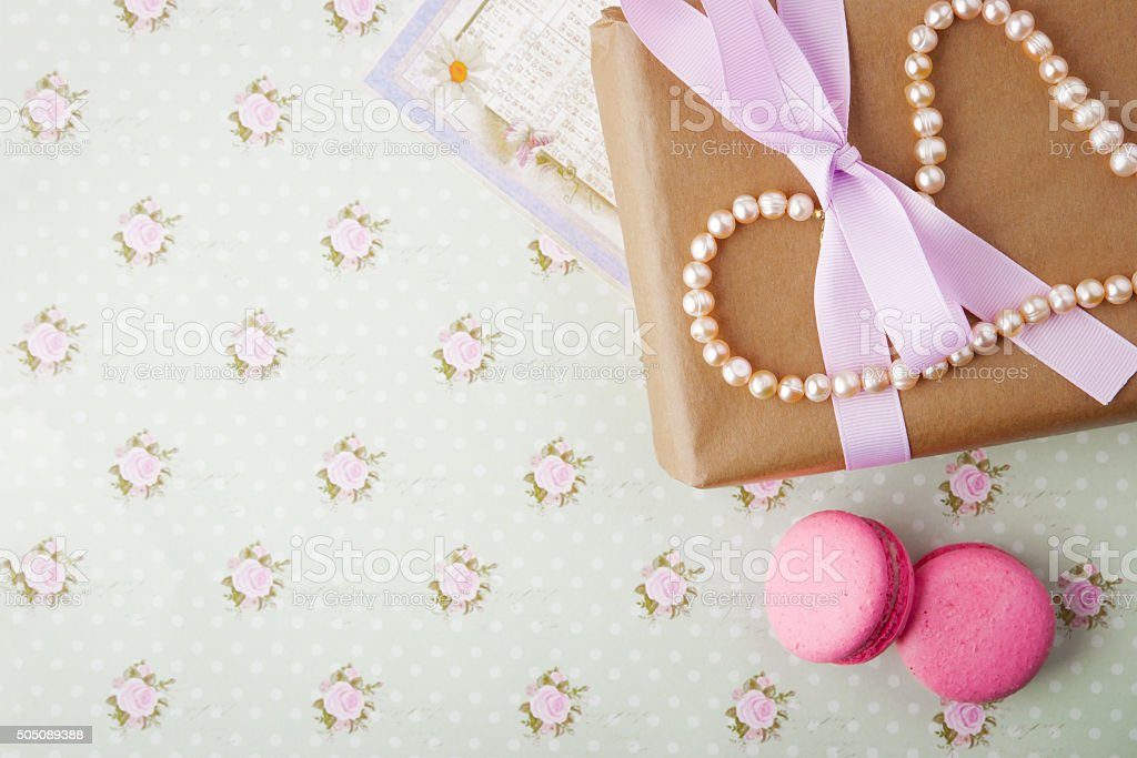 Gift box with pearls in a romantic vintage style stock photo