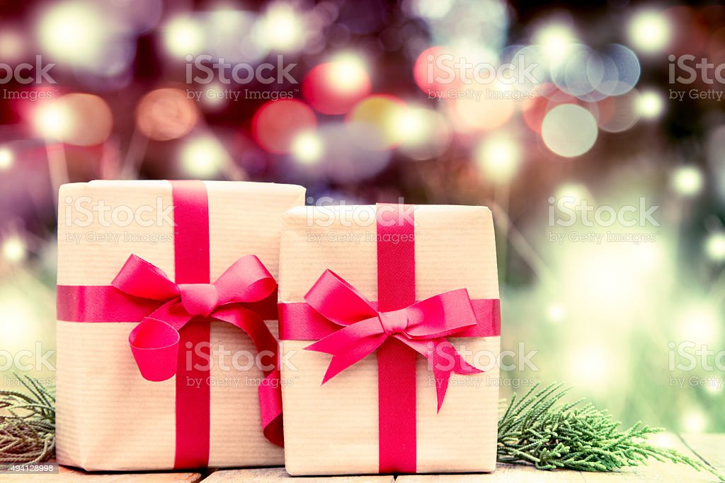 gift box with red bow on glitter bokeh background stock photo