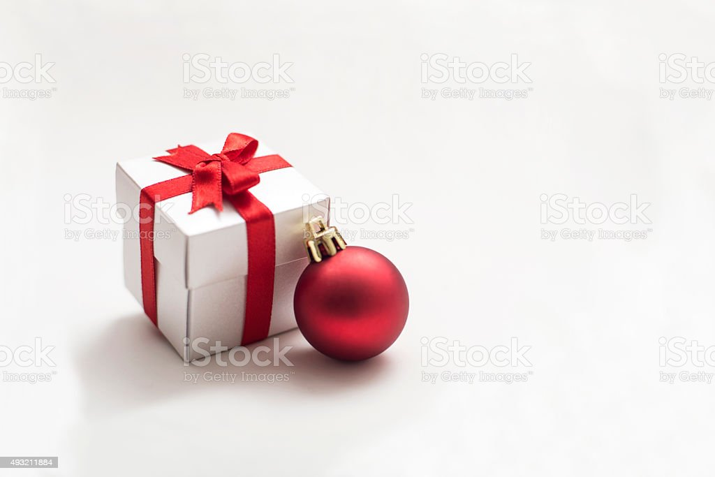 Gift box with Red Christmas Bauble stock photo