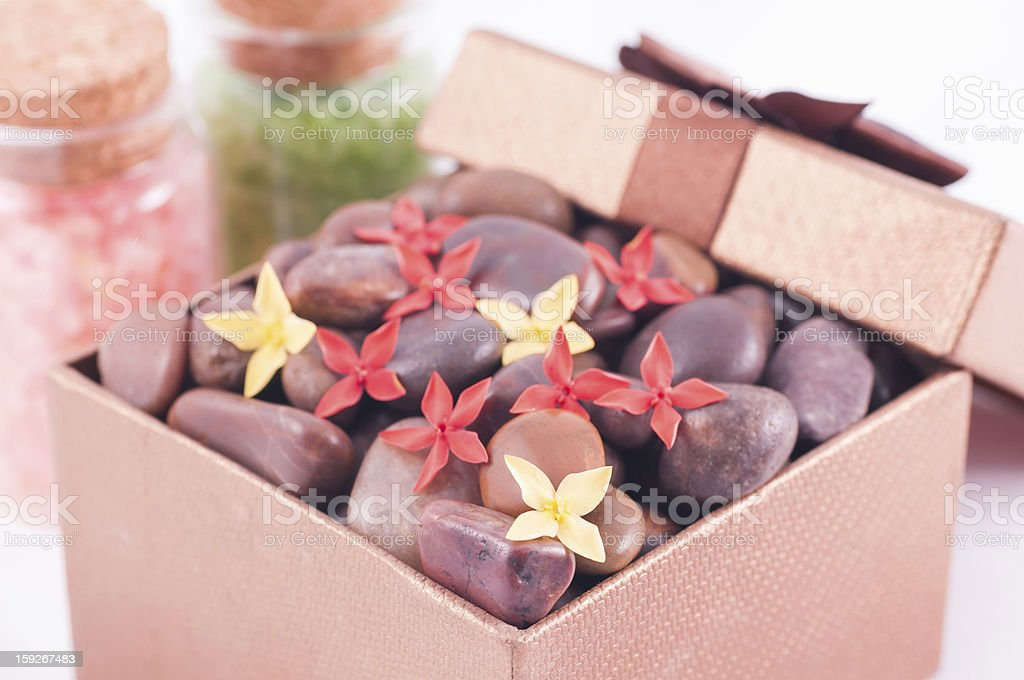 Gift box with red zen stones, flowers and bath salts royalty-free stock photo