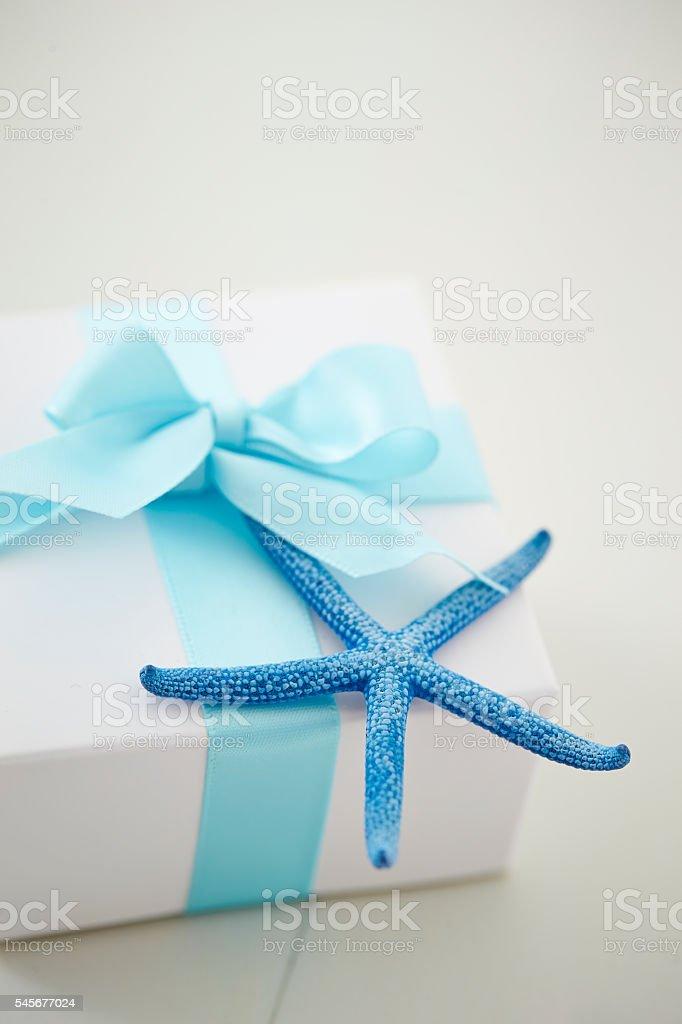 Gift box with starfish stock photo