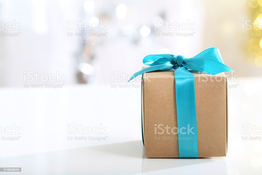 Gift box with Teal bow stock photo