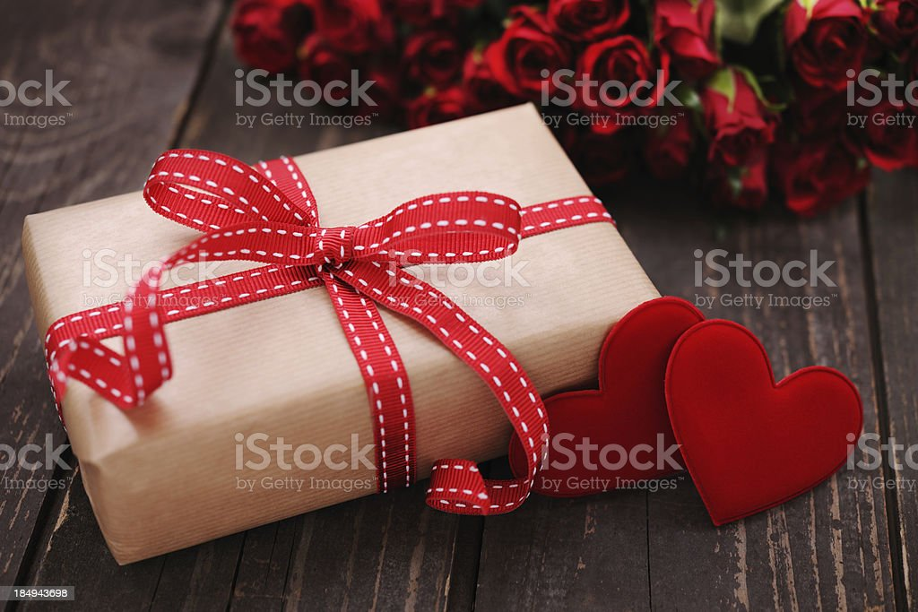 Gift box with two red hearts and roses royalty-free stock photo