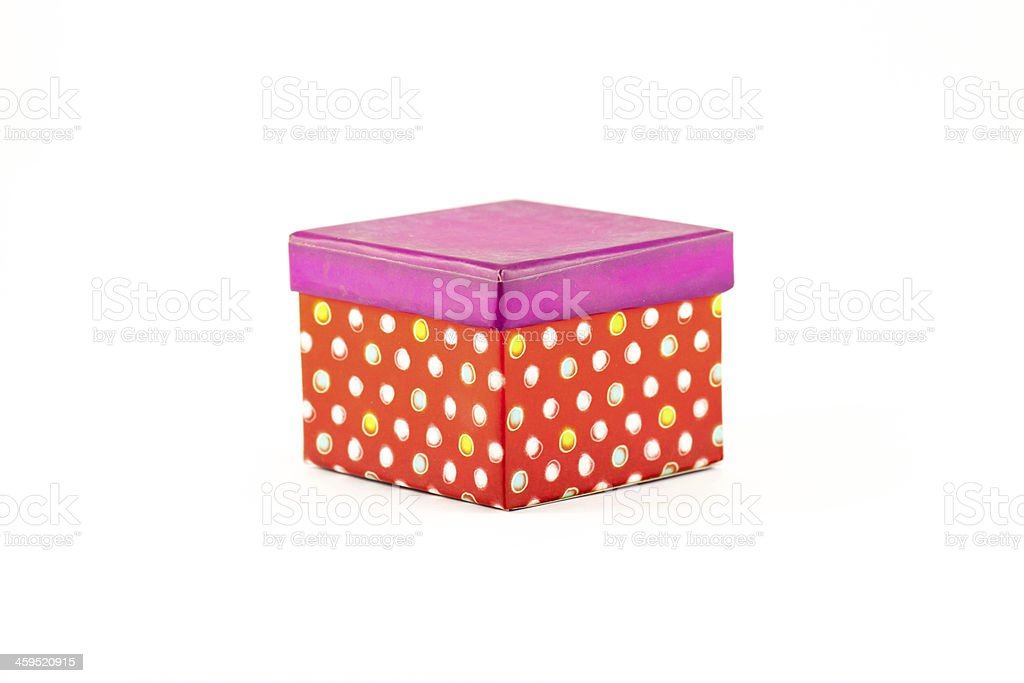 Gift box with white balls on red background stock photo