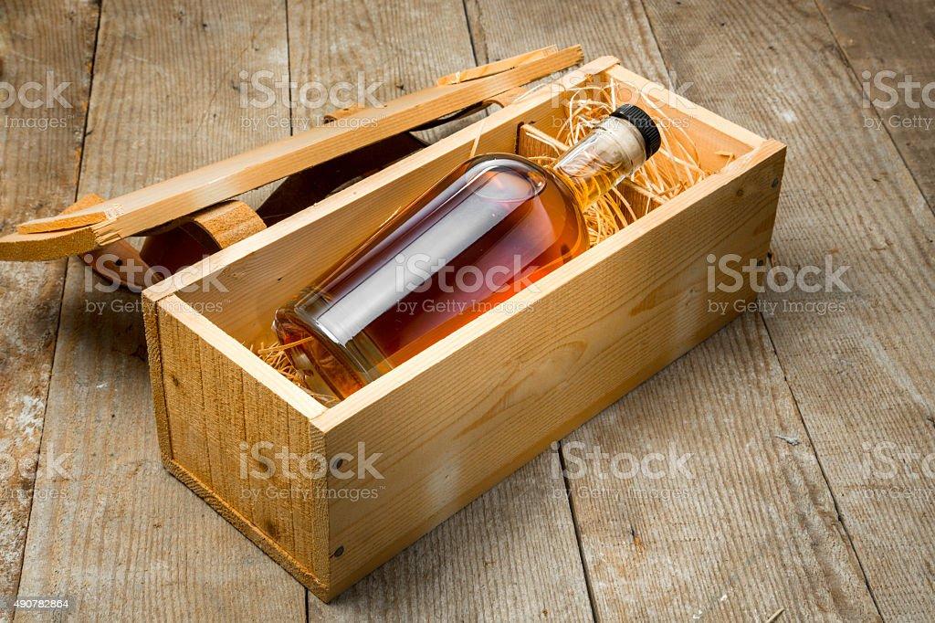 Gift box wooden crate barrel whisky bourbon liquor whiskey bottle stock photo