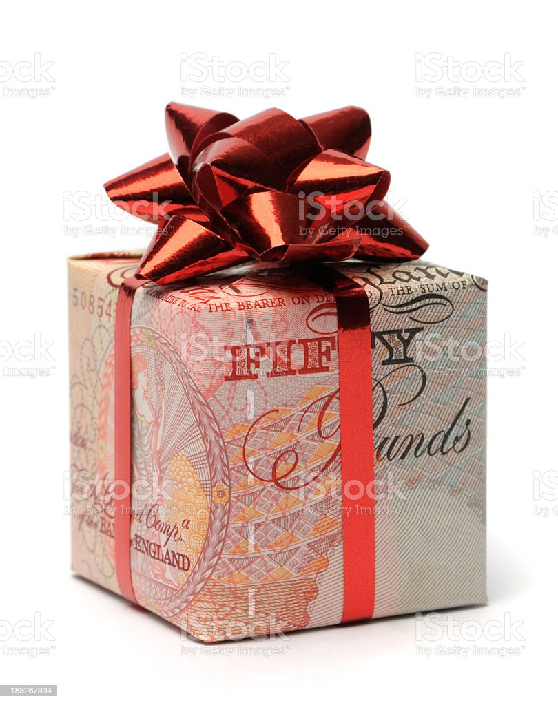 Gift box wrapped in an English pound with a red bow stock photo