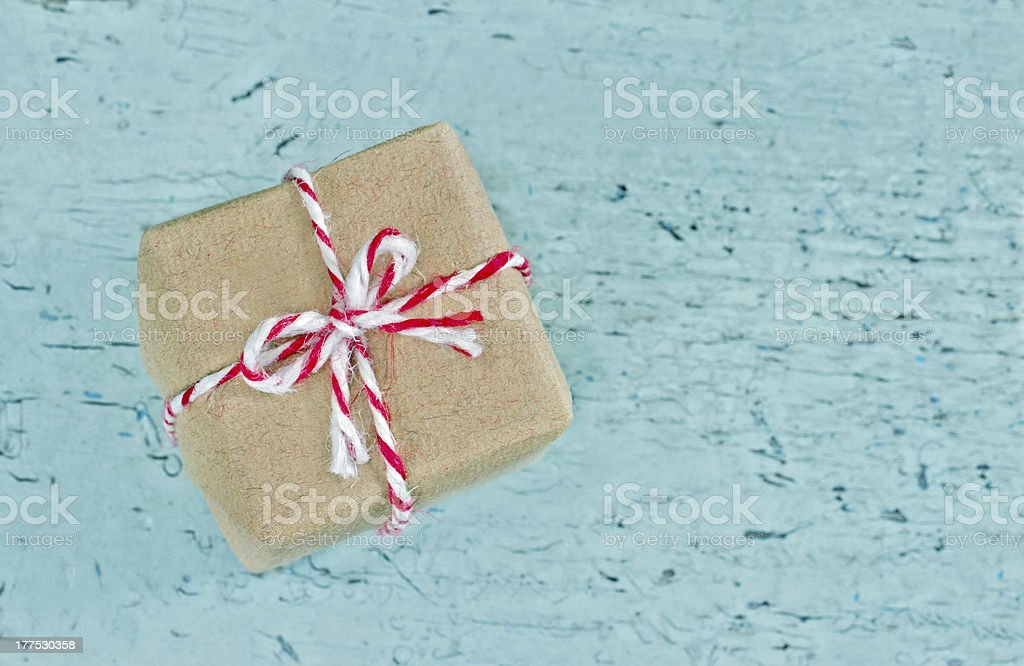 Gift box wrapped in brown paper with red striped string royalty-free stock photo