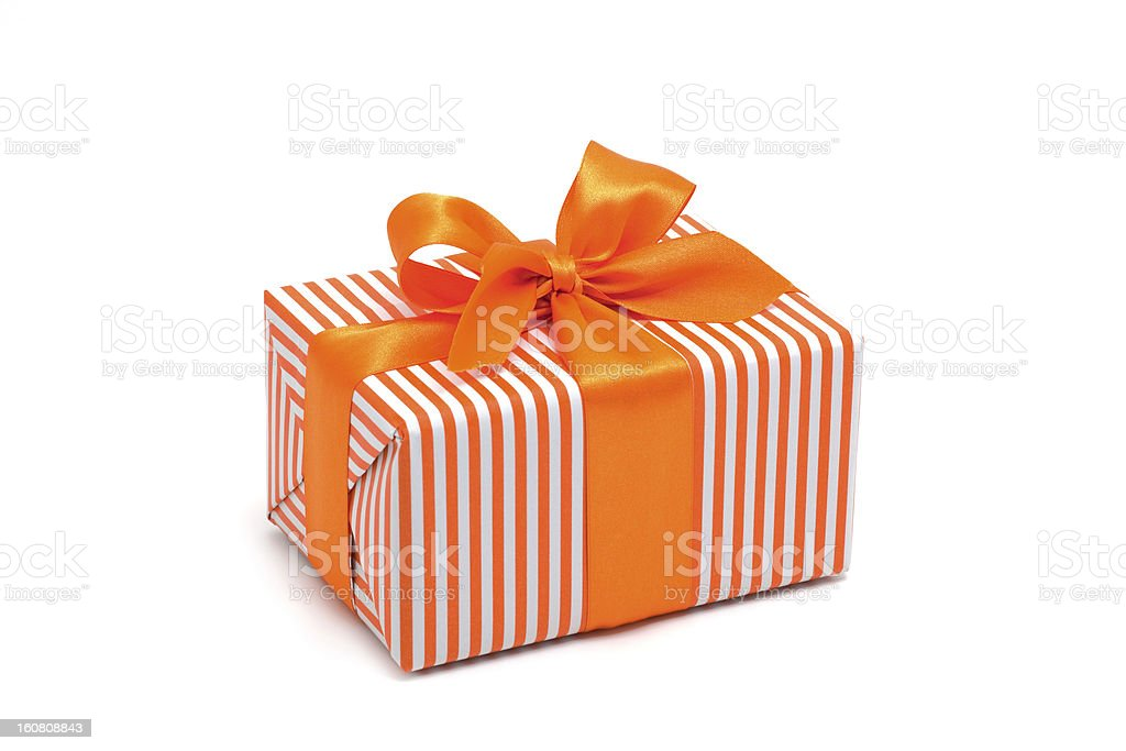 Gift box wrapped in orange stripped paper with an orange bow royalty-free stock photo